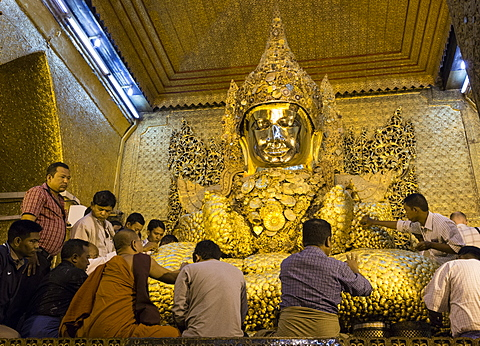 Mahamuni Paya Buddha Temple, most sacred Buddha image in Myanmar covered in six inches of gold leaf, devotees applying gold leaf, Mandalay, Myanmar (Burma), Asia - 1170-176