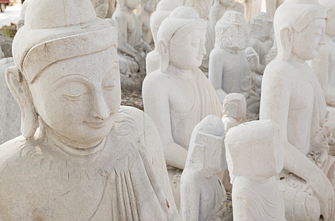 White marble Buddha statues awaiting completion, Stone carvers district, Amarapura, near Mandalay, Myanmar (Burma), Asia