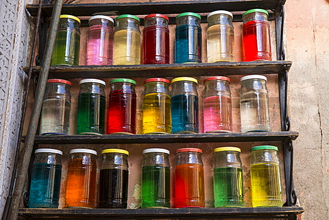 Coloured perfumes in glass jars in the souk, Old Medina, Marrakesh (Marrakech), Morocco, North Africa
