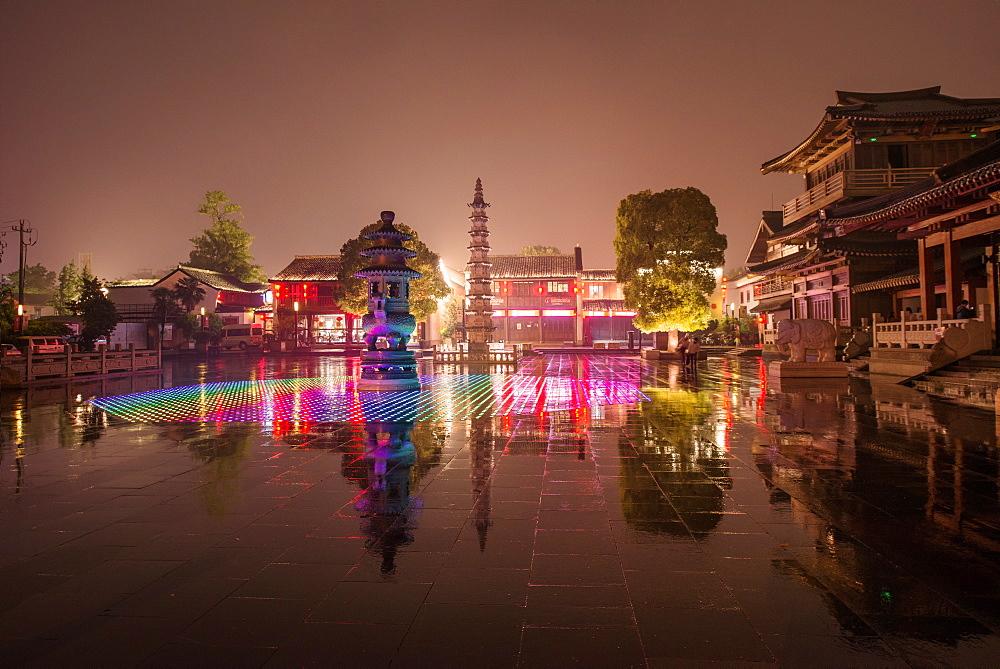 Reflections of LED lighting in the rain at Xiangji Temple, Hangzhou, Zhejiang, China, Asia