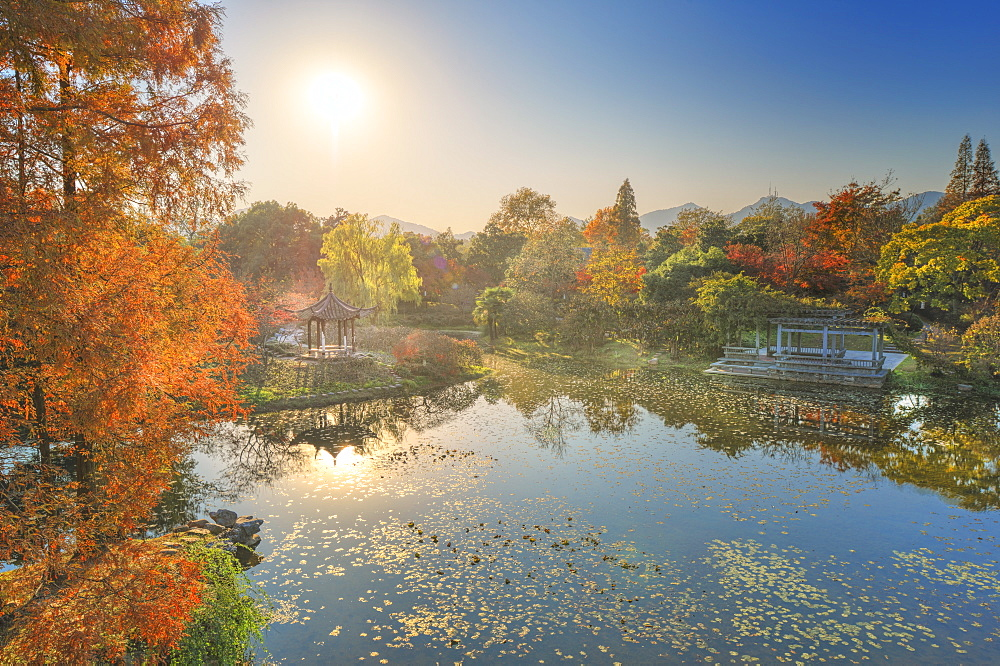 Elevated view of small pagoda in autumn in a wide park scene in Hangzhou, Zhejiang, China, Asia