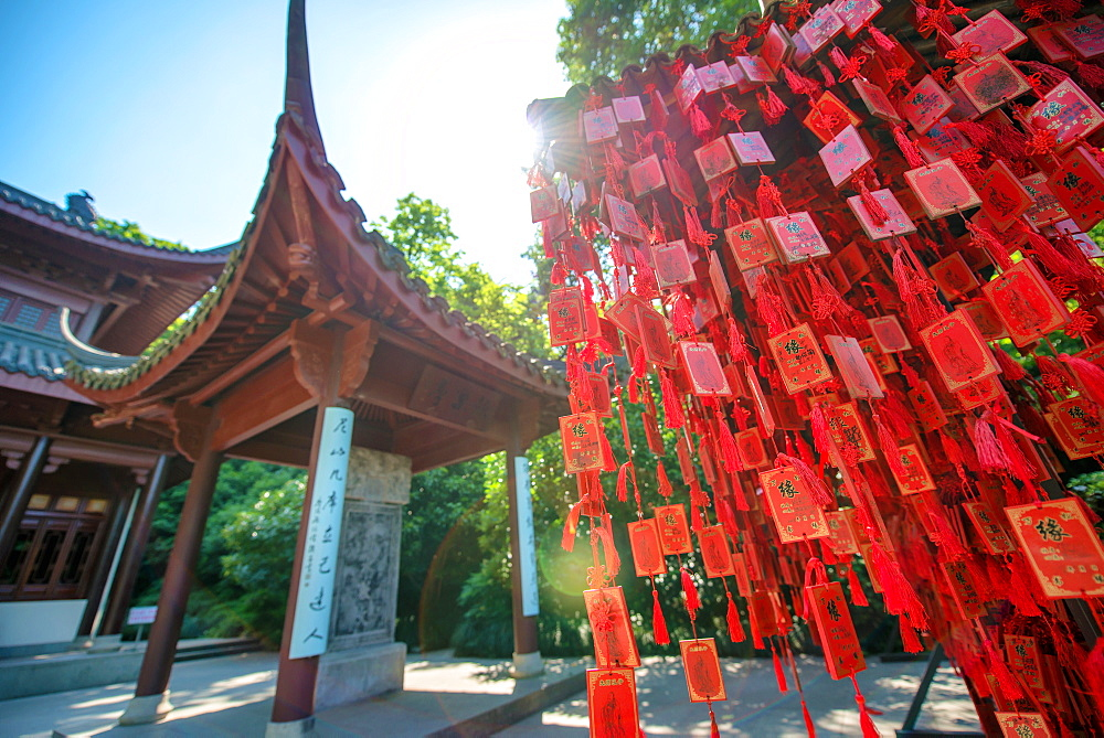 Red wooden traditional Chinese good luck charms and pagoda in background, Hangzhou, Zhejiang, China, Asia
