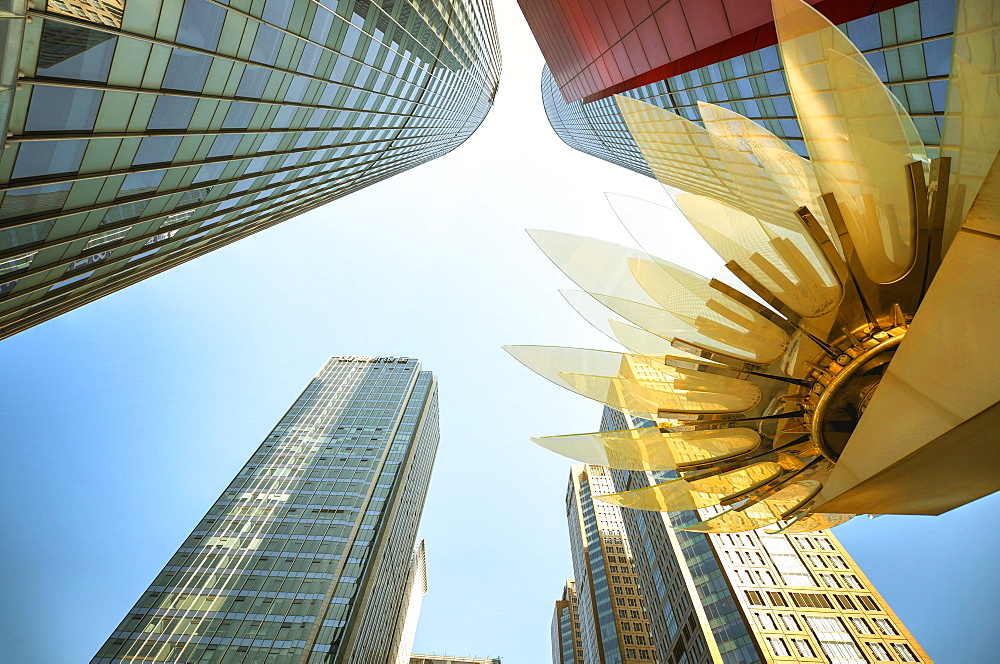 Glass and golden metal Lotus installation in front of HSBC Bank with surrounding new skyscrapers in Jianggan district, Hangzhou, Zhejiang, China, Asia