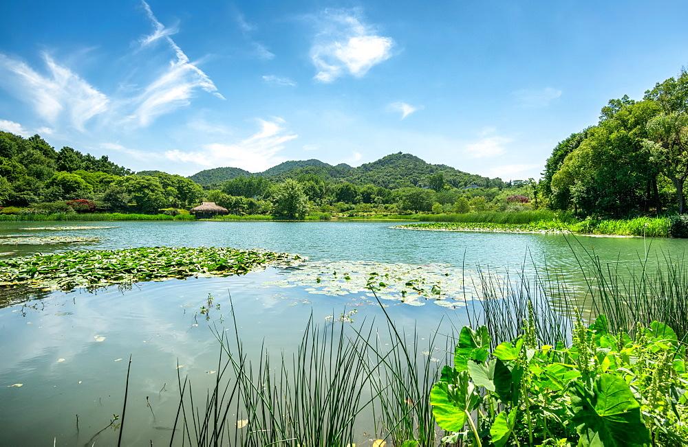 West Lake landscape with green hills, lake and blue sky, Hangzhou, Zhejiang, China, Asia