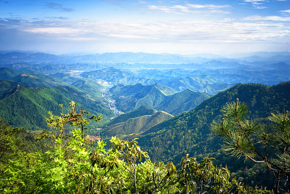 Misty mountain chains and valley with village as seen from Tian Mu Shan peak, Zhejiang, China, Asia