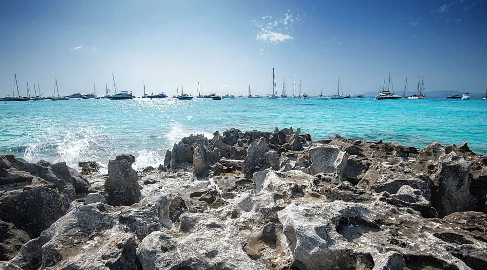 Jagged rocks with sailboats idling in the azure waters of Formentera, Balearic Islands, Spain, Mediterranean, Europe - 1171-201