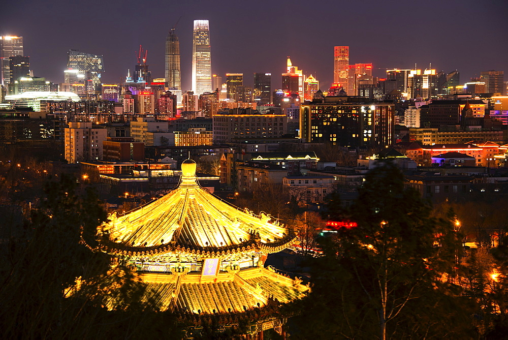 Illuminated pagoda and Beijing cityscape at night, Beijing, China, Asia