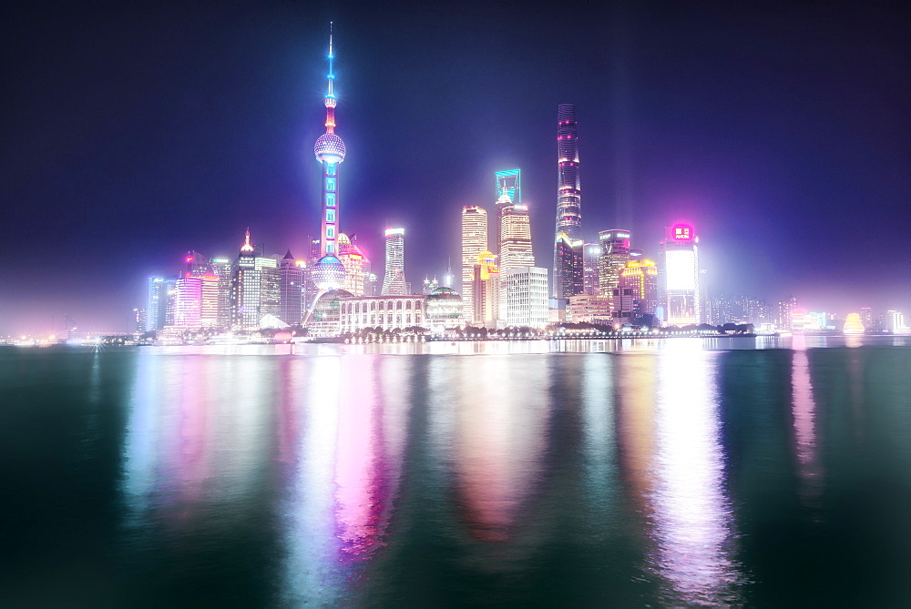 Foggy yet colorful skyline Shanghai Pudong at night. - 1171-268