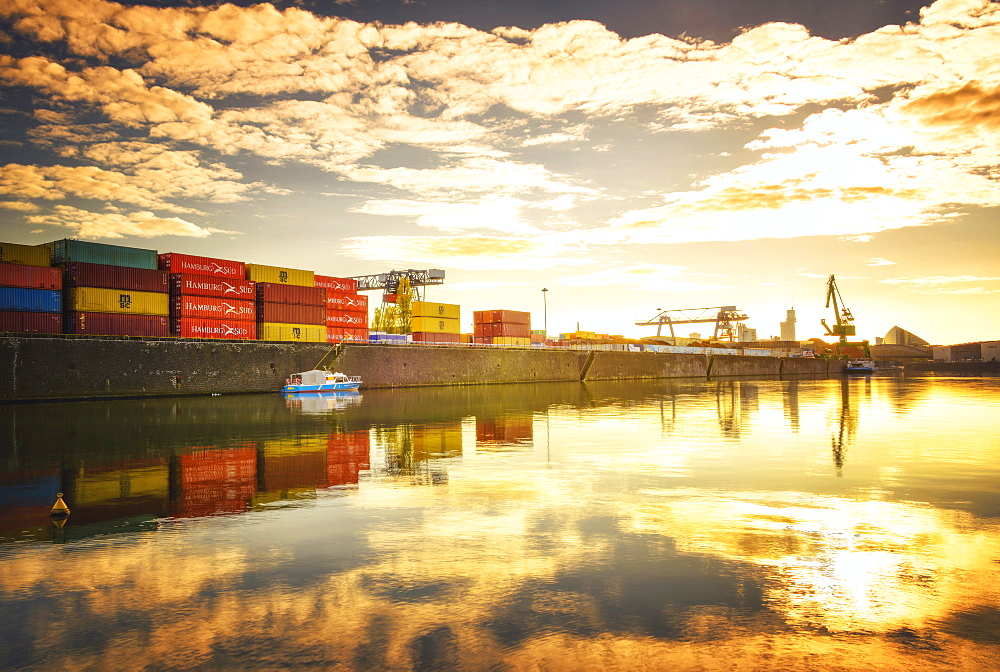 One of Main River's side channels with stacked containers and golden reflections in an industrial setting, Frankfurt, Hesse, Germany, Europe