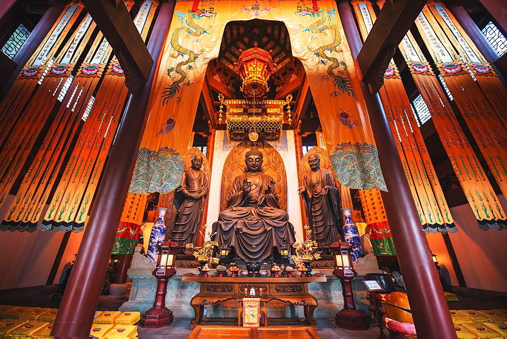 Interior architecture and Ru Lai Buddha statue at Lingyin Monastery in Hangzhou, Zhejiang, China, Asia
