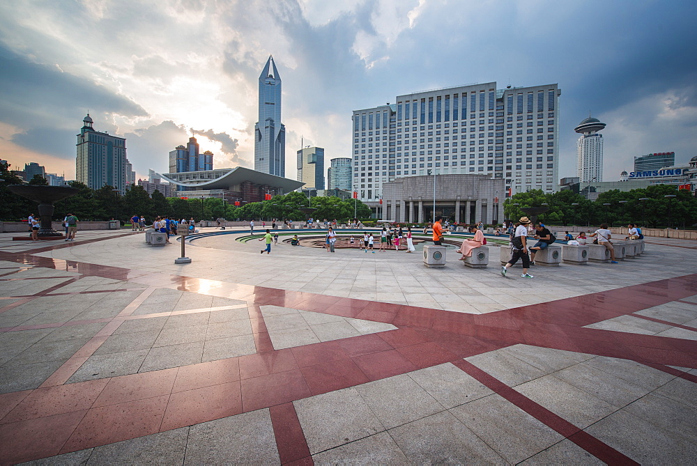 People relaxing and playing at People's Square after work, Shanghai, China, Asia