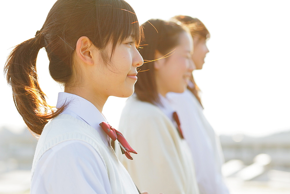 Portrait of Japanese schoolgirls in their uniforms looking away