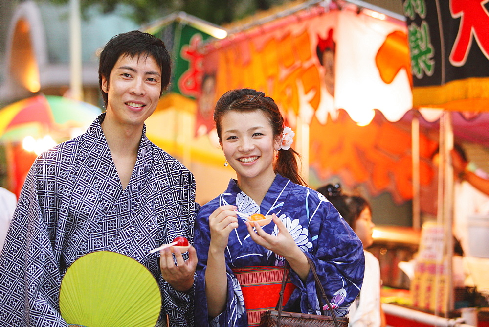 Young Japanese Couple Wearing Yukata at Summer Festival