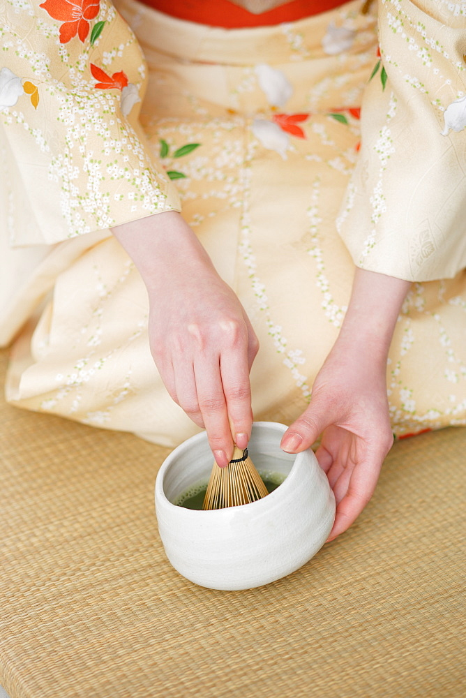 Woman Preparing Herbal Tea