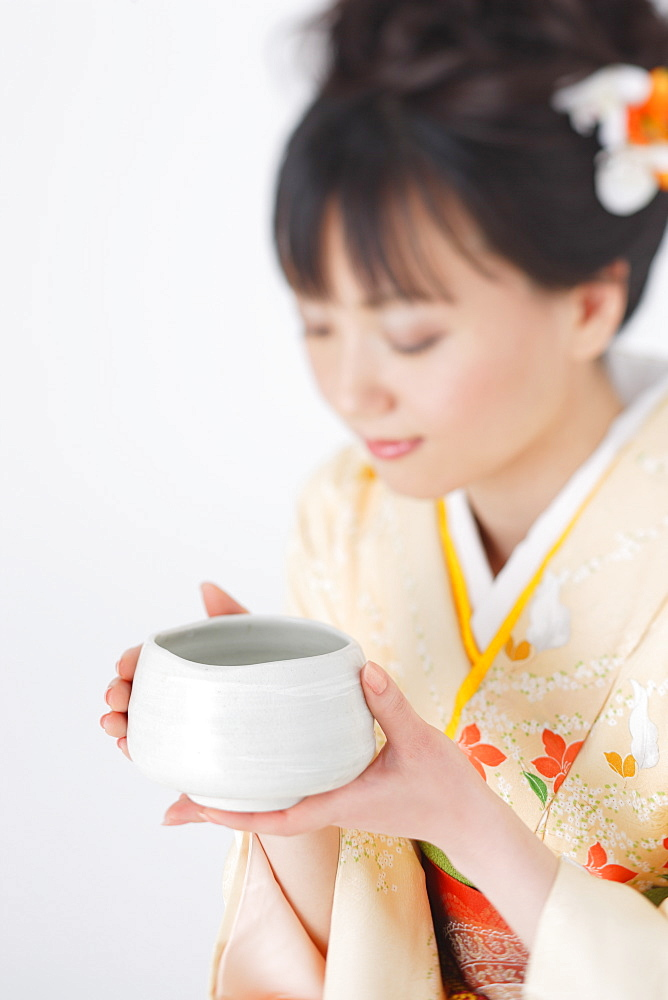 Japanese Woman Holding Bowl of Herbal Tea