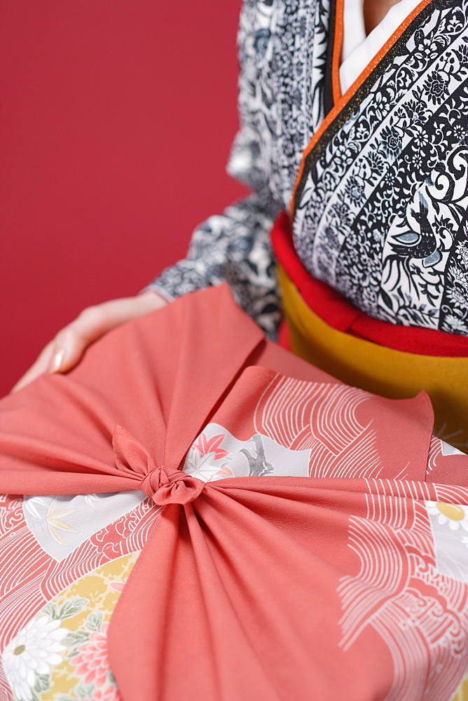 Midsection of Woman Holding Furoshiki