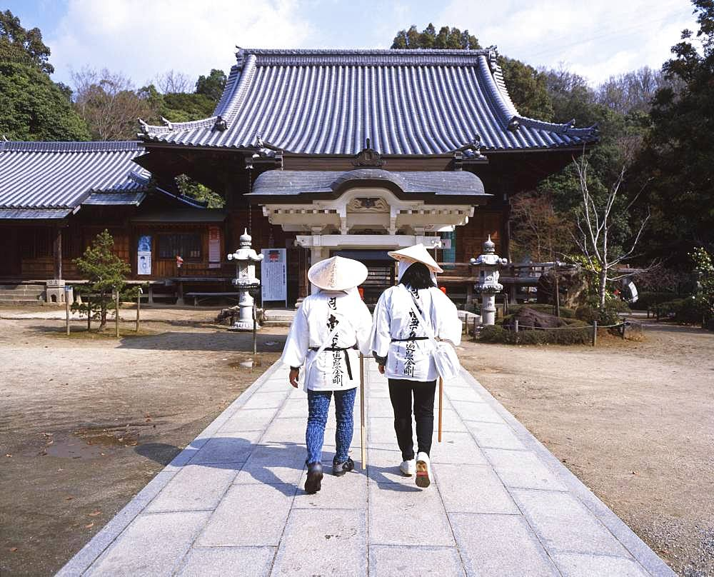 Two women in tradtional Japanese clothes at temple, Tokushima, Japan