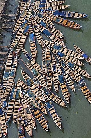 Seagoing fishing canoes in harbor, Ghana, Ghana