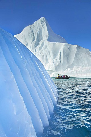 Tourists in zodiac viewing icebergs, Scoresby Sound, East Greenland