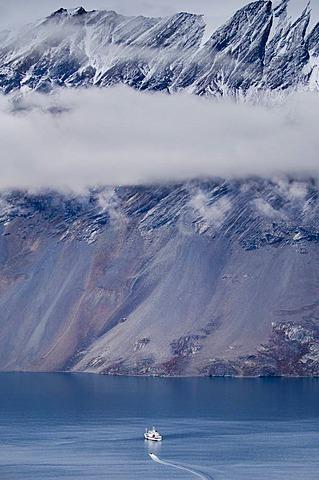 Tourist vessel MS Grigoriy Mikheev in fjord, Polheims Dal, East Greenland