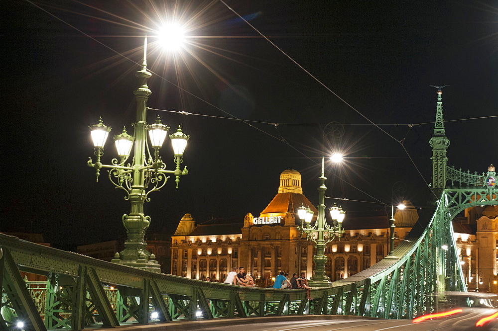Liberty Bridge illuminated at night with the Gellert Hotel in the background, Budapest, Hungary