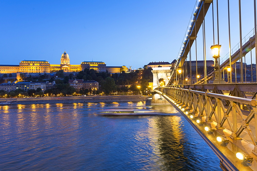 The Chain Bridge by dusk with a view of Buda Castle, Budapest, Hungary