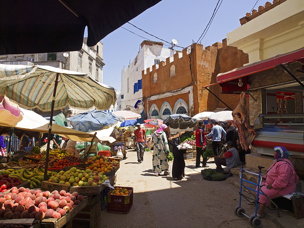 A market on the Socco Chico in the Medina of Larache, Morocco, with the good covered with a sunshade