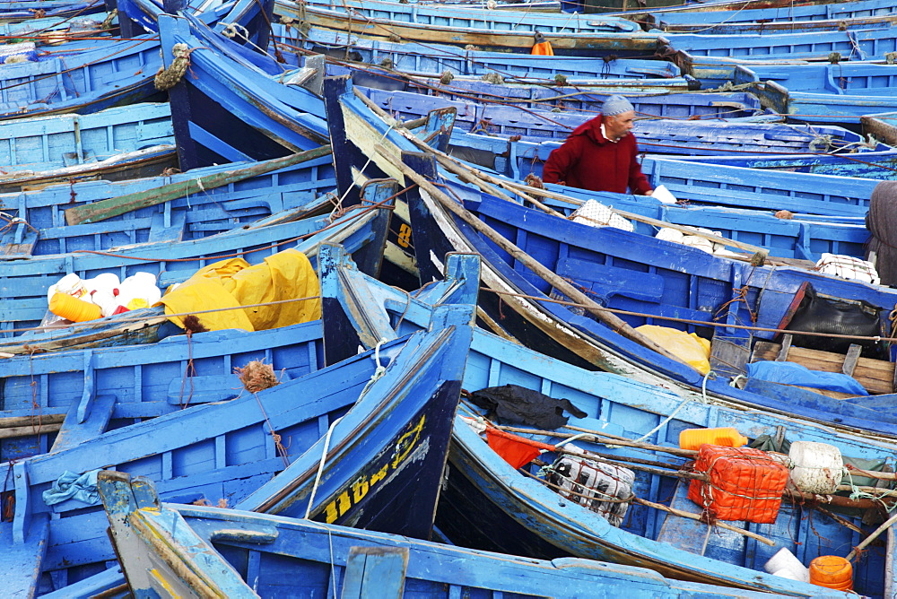 Blue wooden boats in the fishing harbour of the former Portuguese colony, Essaouira, Morocco
