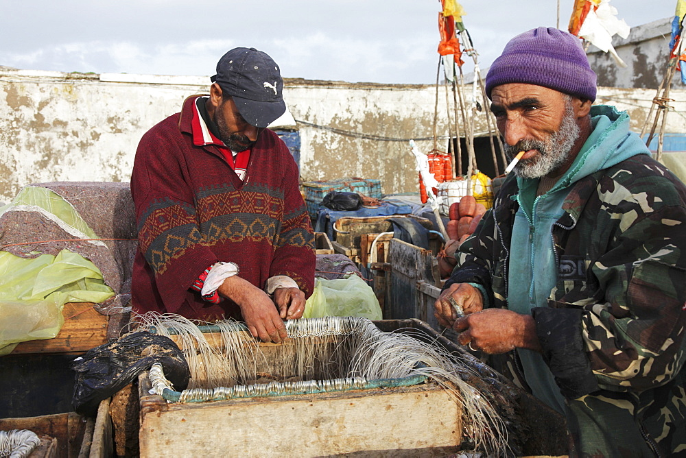 Fishermen in the morning preparing bait in the harbour of the former Portuguese colony, Essaouira Morocco