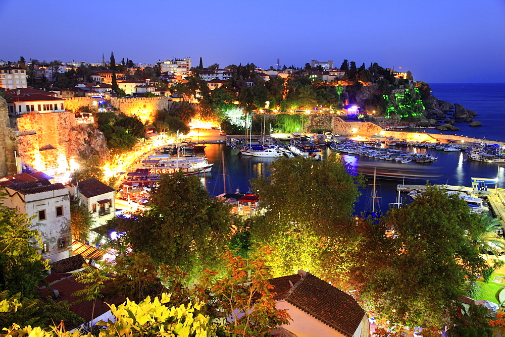 Boats moored in Old Town harbour at night in Antalya, Turkey