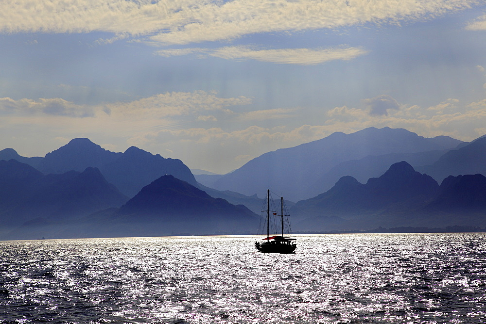 View of mountains and boat in sea at Antalya, Turkey
