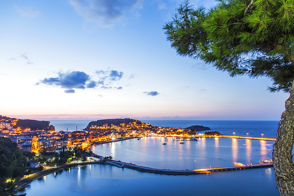 A view the town of Amasra, Turkey, located on two island, with the illumination reflecting in the sea