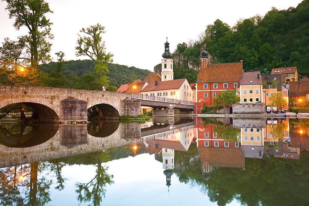 View of bridge, Naab river and medieval village of Kallmunz, Bavaria, Germany
