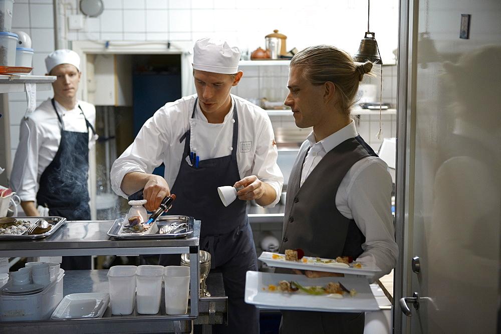 Team Magnus working at Oaxen Krog Restaurant, Stockholm