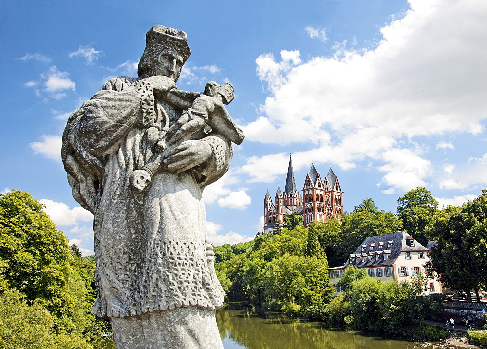View of statue of St John of Nepomuk at Lahn bridge in Limburg, Netherlands