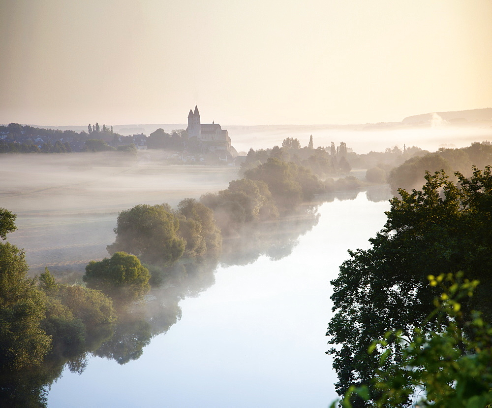 View of St. Lubentius with fog at dawn in Limburg, Dietkirchen, Hesse, Germany