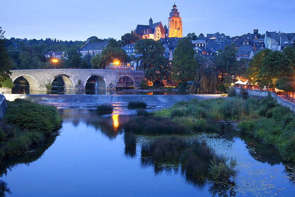 View of Old Lahn Bridge, Cathedral and Old Town at dusk in Lahn, Wetzlar, Hesse, Germany