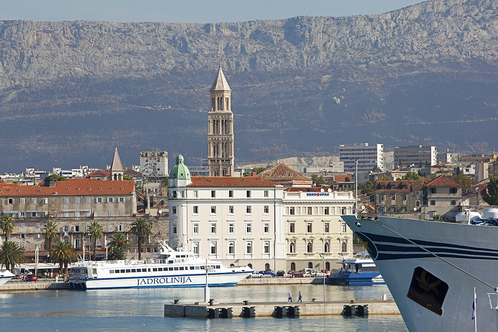 View of old town and ferry in Adriatic sea, Dalmatia, Croatia