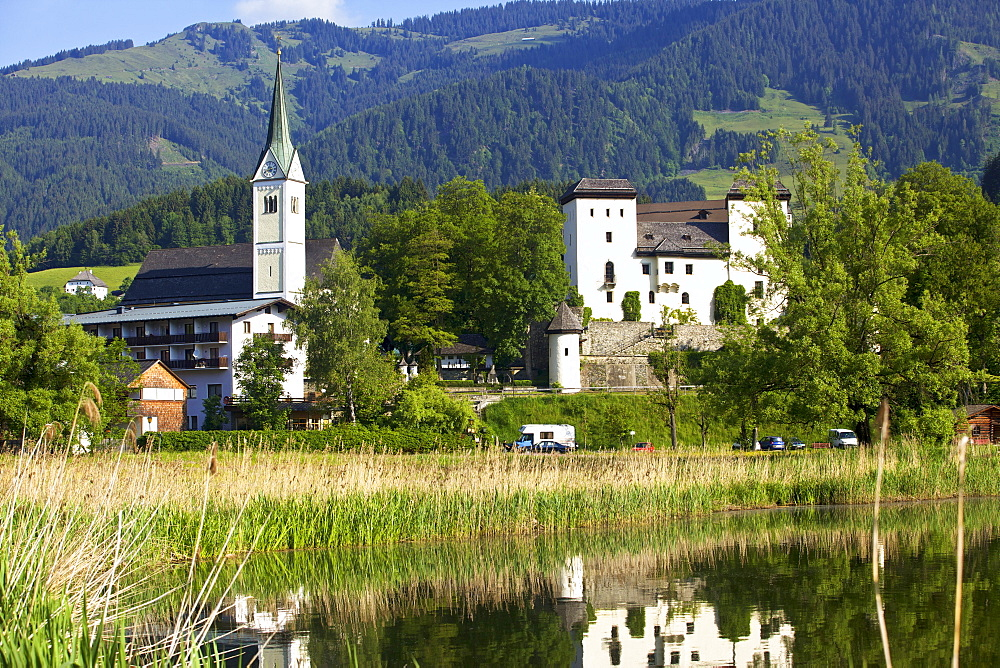 View of Goldegg hotel and Goldegger lake, Austria