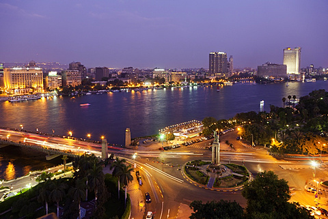 Cityscape of illuminated Tahrir Square and Tahrir Bridge, River Nile, Cairo, Egypt