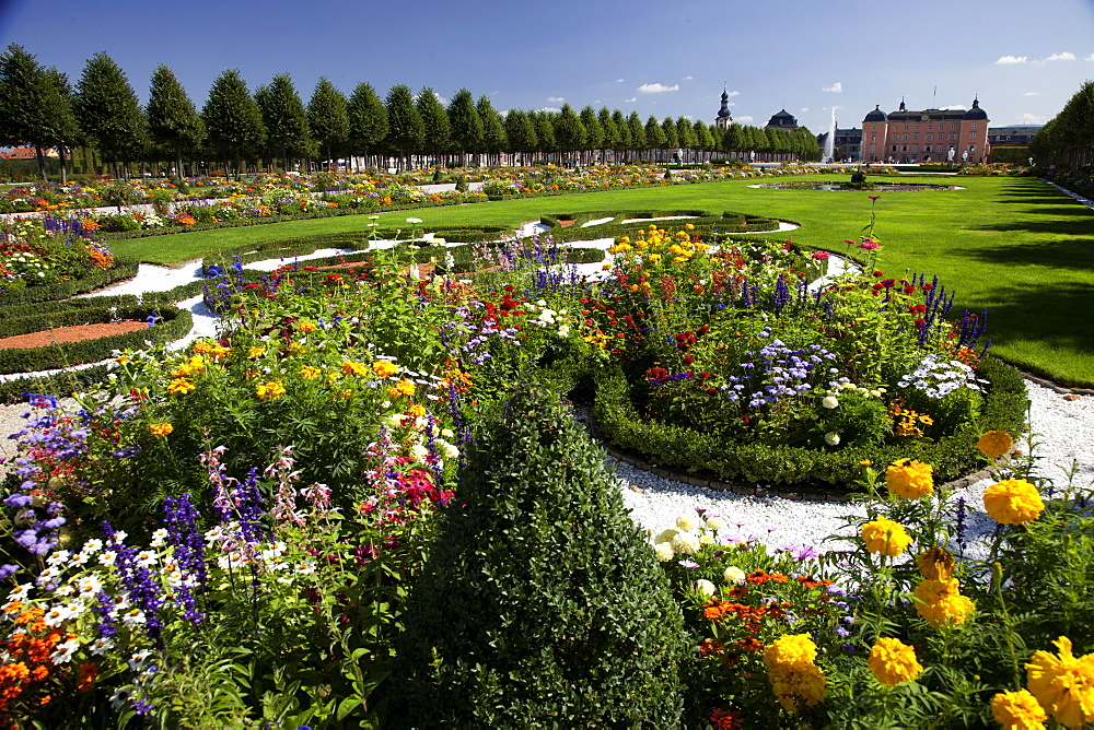 Tourist and different flowers at Schwetzingen Castle park, Baden-Wurttemberg, Germany