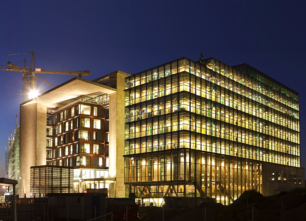 View of illuminated public library and music conservatory in Amsterdam, Netherlands