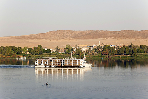 View of Cruise ship on river Nile overlooking mountains, Egypt