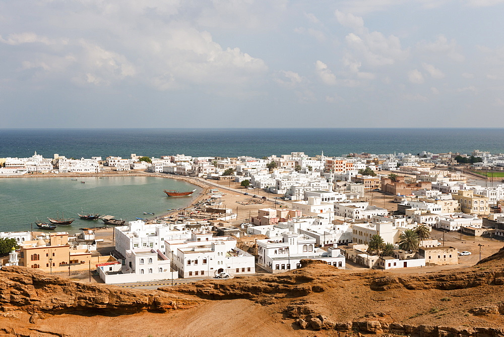 View of town with houses and harbour in Sur, Oman