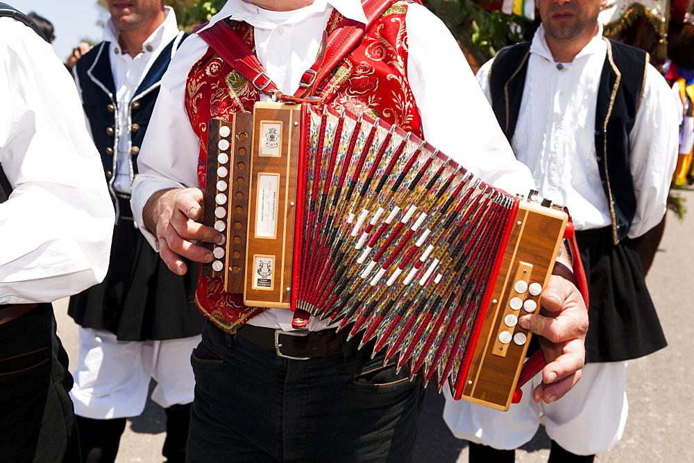 Musicians playing music at Sant'Efisio procession, Pula village, Sardinia, Italy