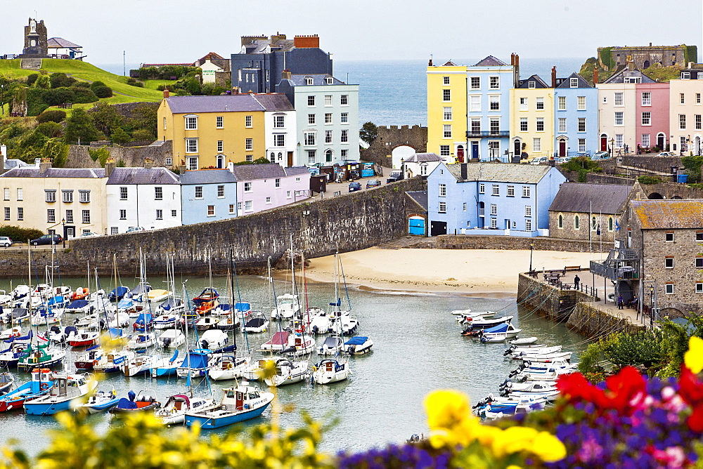 View of colourful buildings and moored boats at Tenby, Pembrokeshire, Wales, UK