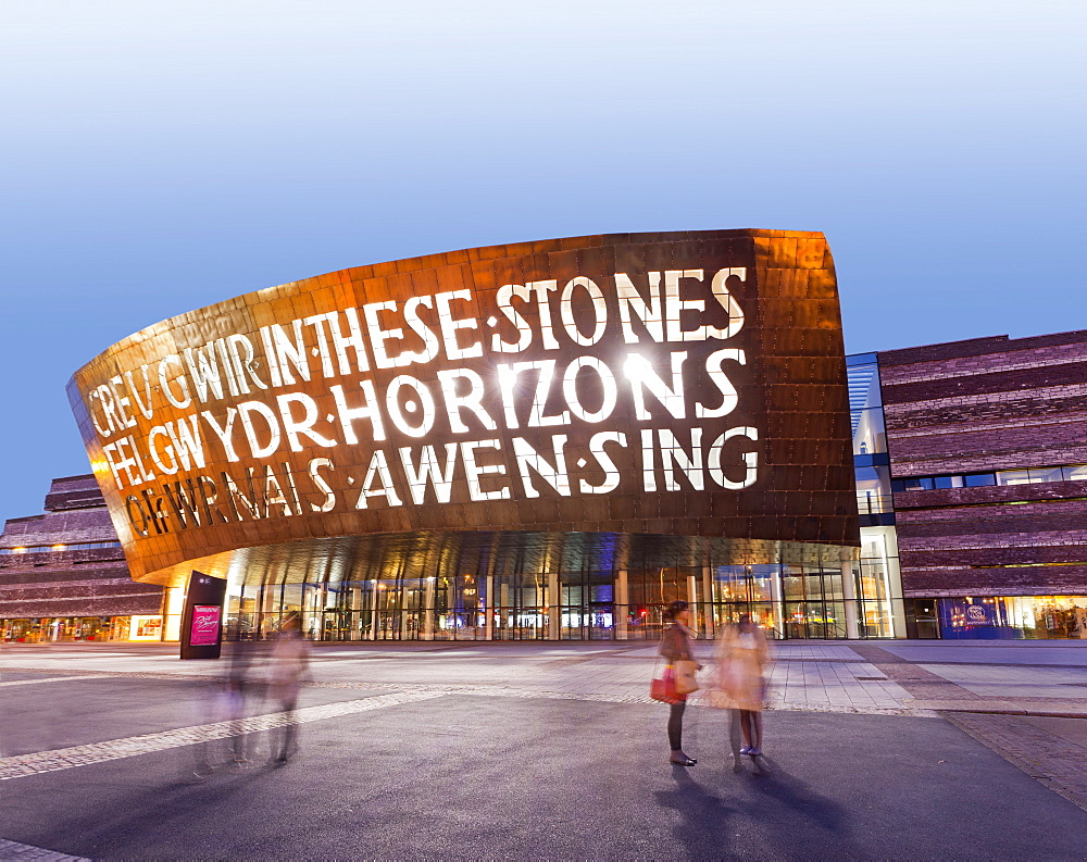 Illuminated exterior of Millennium centre in Cardiff at night, Wales, UK, blurred motion