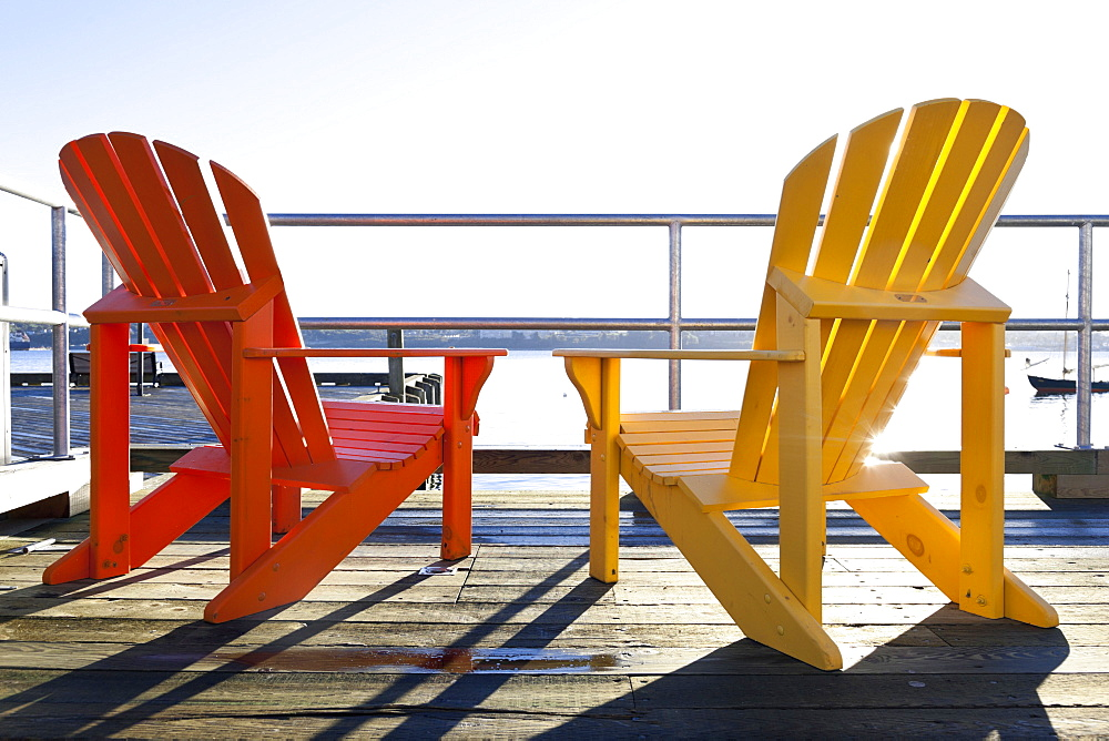 Red and yellow chair on deck at Halifax Regional Municipality, Nova Scotia, Canada