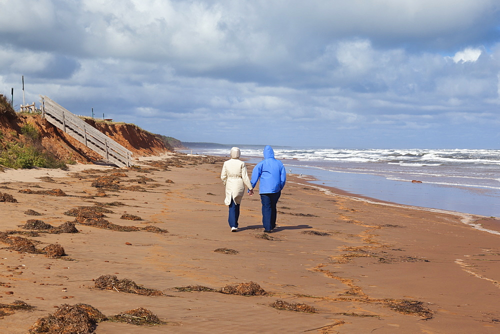 Couple walking on beach of Brackley-Dalvay, Prince Edward island National park, Canada