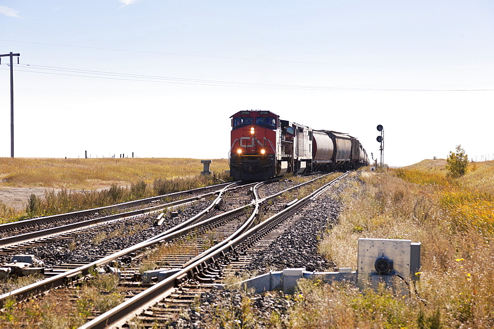 View of train and railway line in Watrous small town, Saskatchewan, Canada